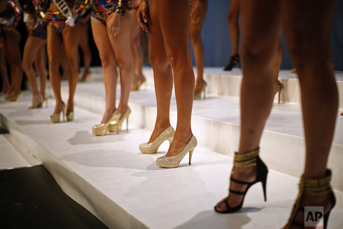 In this Sunday, Sept. 18, 2016 photo, participants line up at the Miss Trans Star International 2016 show celebrated in Barcelona, Spain. Twenty-eight women representing as many countries competed last weekend to be crowned  Miss Trans Star International, Europe's largest beauty pageant for transgender women and one of a growing number of similar events aimed at celebrating a population more often condemned. (AP Photo/Manu Fernandez)
