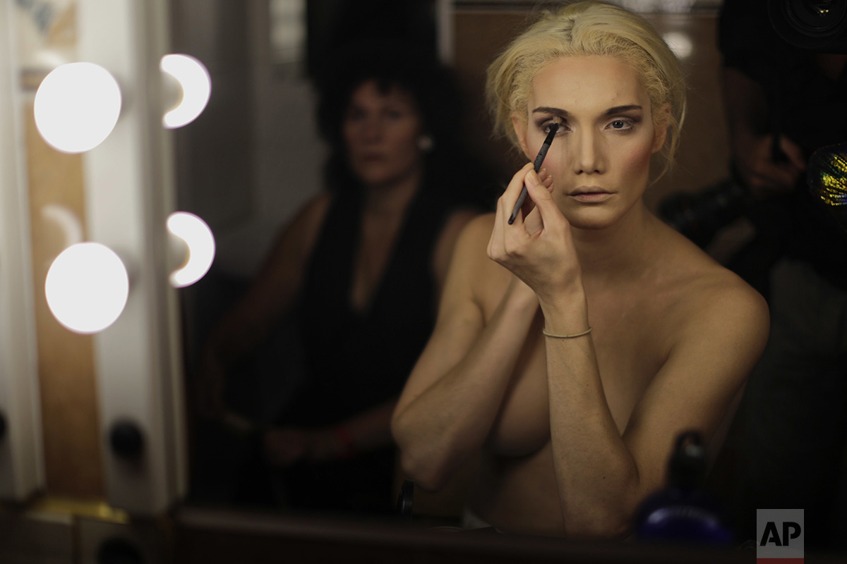 In this Sunday, Sept. 18, 2016 photo, Linni Rows Wiman, from Sweden, applies make up ahead of the Miss Trans Star International 2016 show celebrated in Barcelona, Spain. (AP Photo/Emilio Morenatti)