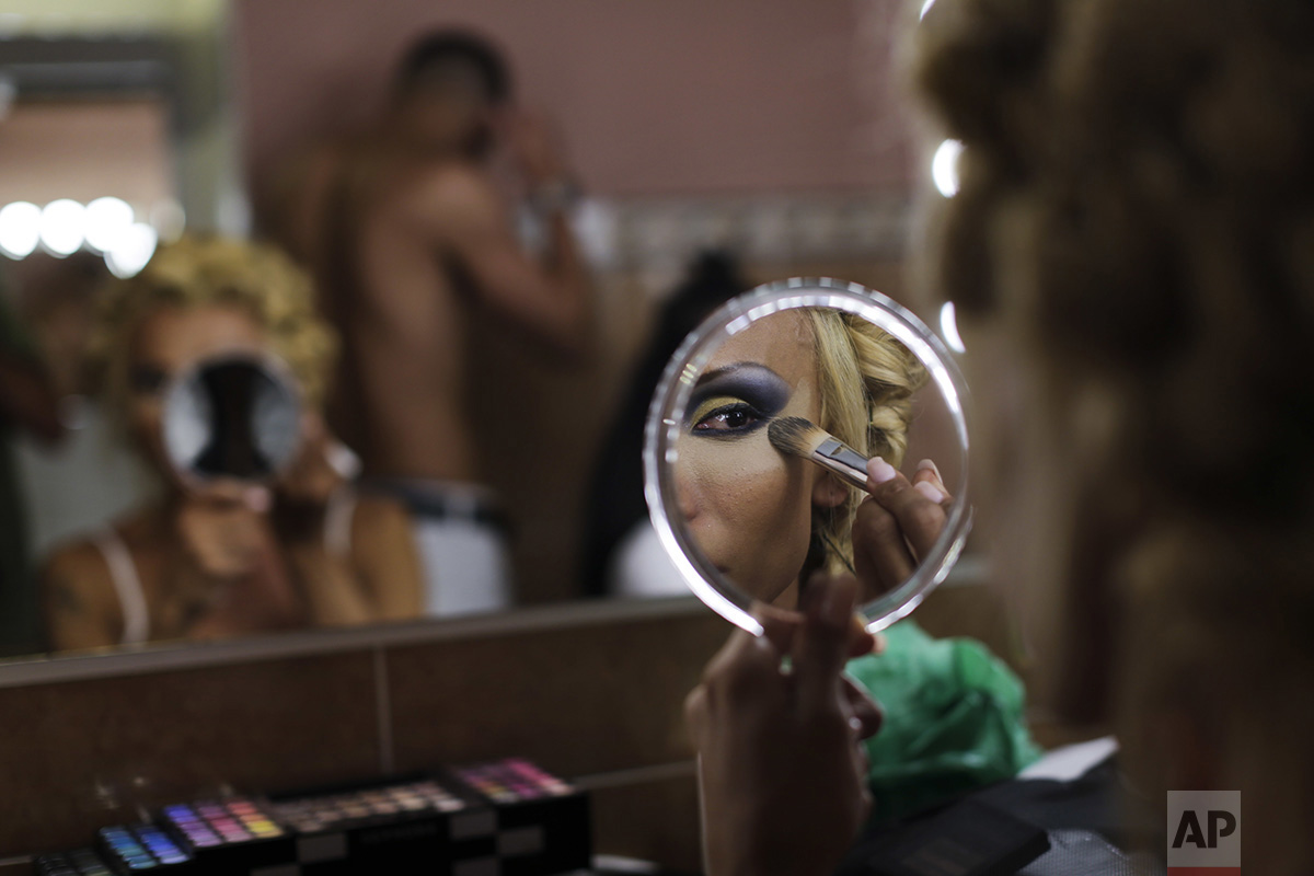 In this Sunday, Sept. 18, 2016 photo, Jey Jonnais, from Panama, applies make up ahead of the Miss Trans Star International 2016 show celebrated in Barcelona, Spain. (AP Photo/Emilio Morenatti)