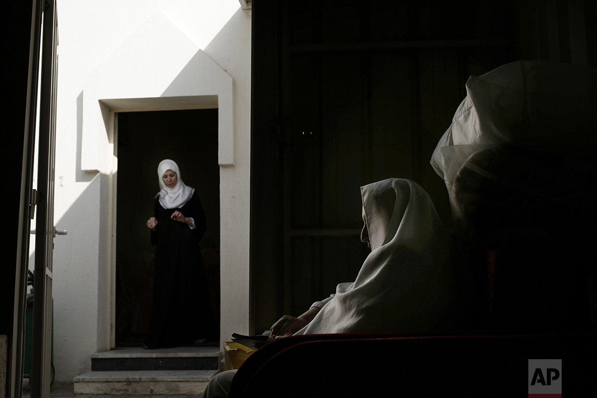 In this Sunday, Sept. 11, 2016 photo, an Egyptian woman prays inside the women's camp in Arafat during the annual hajj pilgrimage, near the holy city of Mecca, Saudi Arabia. The pilgrimage, required of able-bodied Muslims once in their life, brings the Islamic world together across its many languages, ethnicities and individual beliefs. That's something seen across the many faces of its female faithful. Many who took part in this year's pilgrimage described finding peace and fulfillment by taking part in it.(AP Photo/Nariman El-Mofty)