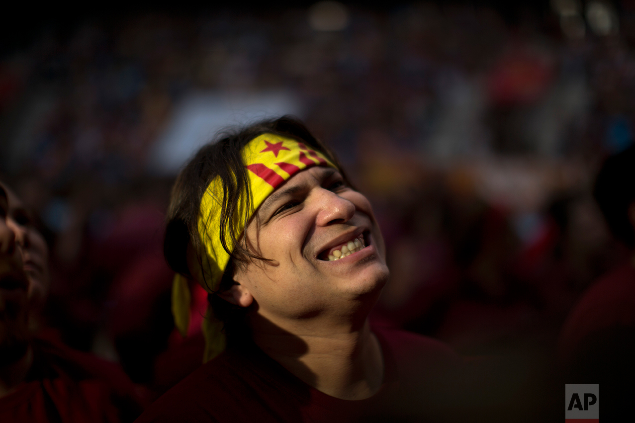 In this Saturday, Oct. 1, 2016 photo, Victor Verges, 31, reacts as he looks at members of Xiquets de Hangzou trying to complete their human tower, during the 26th Human Tower Competition in Tarragona, Spain. (AP Photo/Emilio Morenatti)