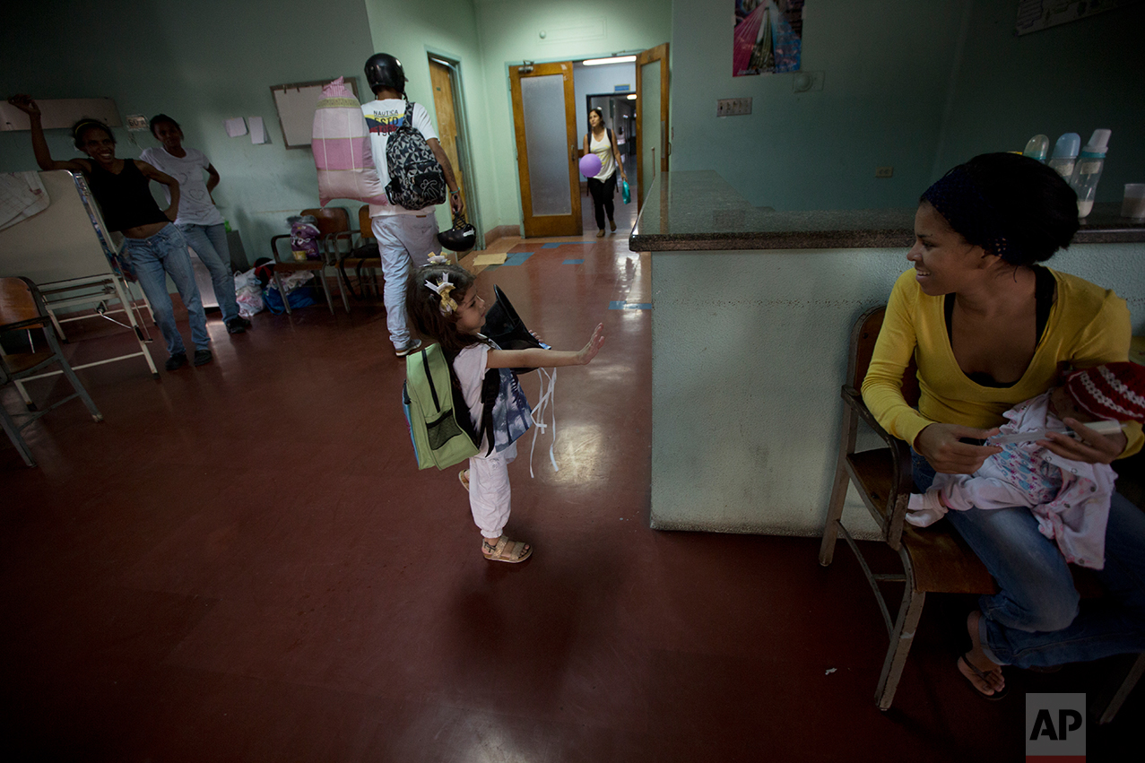 """In this Sept. 19, 2016 photo, 3-year-old Ashley Pacheco waves goodbye after she was discharged from University Hospital in Caracas, Venezuela. """"I really don't know of any other country where things have deteriorated so quickly, to such an incredible extent,"""" said Rafael Perez-Escamilla, a Yale University School of Public Health professor who has worked in Latin America and Africa. """"Venezuela's health system was a model for Latin America. Now you are seeing an implosion where people cannot get basic care."""" (AP Photo/Fernando Llano)"""
