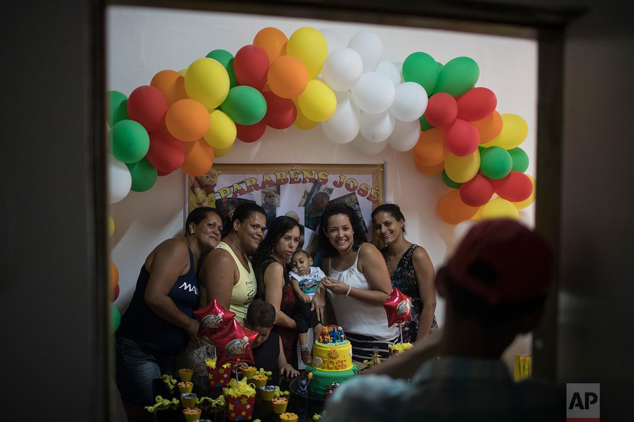 In this Oct. 1, 2016 photo, Rozilene Ferreira and her husband Elias Rodrigo celebrate the one-year birthday of their son Arthur, who was born with microcephaly, in Recife, Pernambuco state, Brazil. (AP Photo/Felipe Dana)