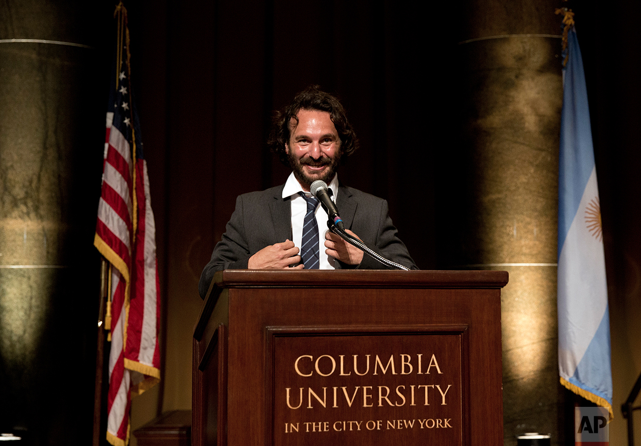 Photographer Rodrigo Abd of The Associated Press speaks during the award ceremony at Columbia University in New York City, Tuesday Oct. 18, 2016. Abd and three other journalists in Brazil, Colombia and El Salvador received this year's Maria Moors Cabot Prize. (AP Photos/Enric Marti)