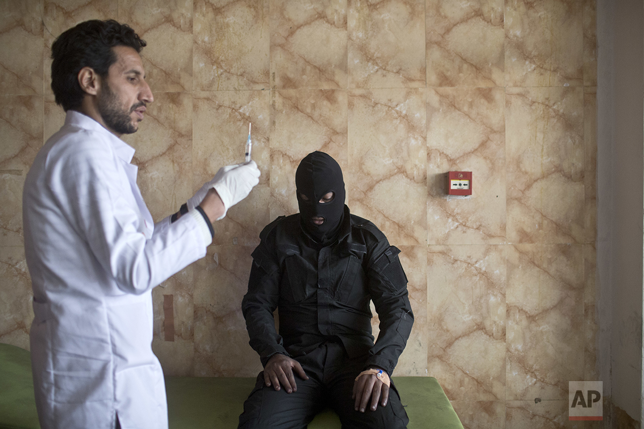 A member of the Iraqi security forces gets medical attention after inhaling sulfur fumes, at a hospital in Qayyarah, about 31 miles (50 km) south of Mosul, Iraq, Sunday, Oct. 23, 2016. Islamic State fighters torched a sulfur plant south of Mosul, sending a cloud of toxic fumes into the air that mingled with oil wells the militants had lit on fire to create a smoke screen. (AP Photo/Marko Drobnjakovic)