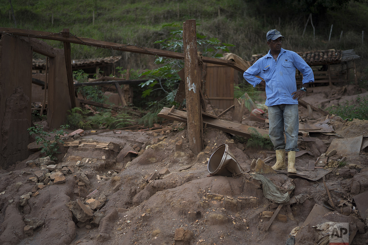 """In this Oct, 13, 2016 photo, Geraldo de Oliveira stands on the rubble of his home destroyed by a Nov. 5, 2015 mudslide unleashed by the bursting of a mine-waste basin, in Paracatu, Brazil. """"This place used to be a paradise. It was the most beautiful thing you've ever seen,"""" said Oliveira. (AP Photo/Leo Correa)"""