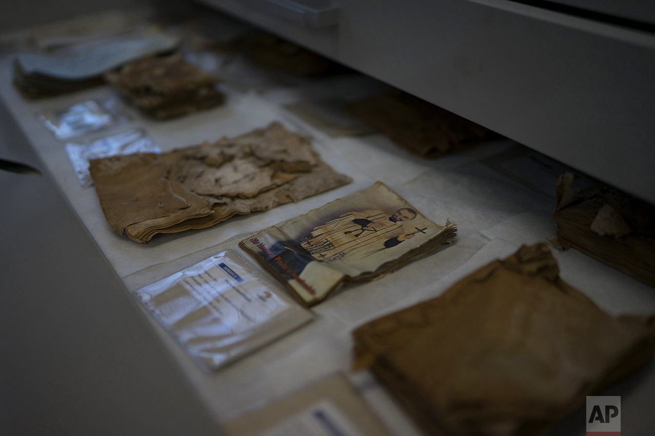 This Oct. 14, 2016, photo shows religious items found in the Doce River, at a recovery center in Mariana, Brazil. Almost two thousand religious icons from the surrounding villages of the Doce River Valley, were washed into the river because of a mudslide triggered by the Nov. 5, 2015 failing of a dam holding back a giant pond of mine waste. (AP Photo/Leo Correa)