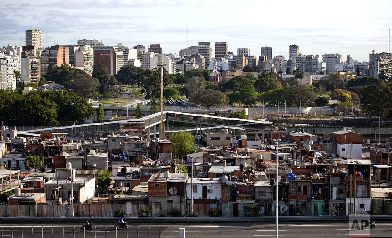 """This Oct. 4, 2016 photo shows the Villa 31 neighborhood, backdropped by downtown, as well as middle class apartments and office buildings in Buenos Aires, Argentina. Many of the country's poor live in the slums known as """"Misery Villages,"""" where they often lack access to transportation, running water or sewage. (AP Photo/Natacha Pisarenko)"""