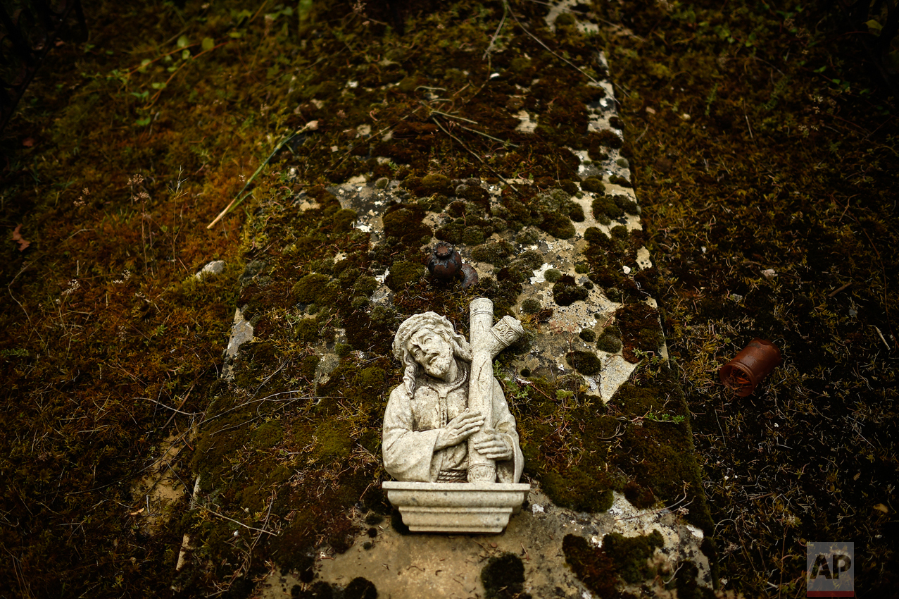 A cross on top of a grave at the state cemetery during All Saints Day, a Catholic holiday to reflect on the saints and deceased relatives, in Pamplona, northern Spain, Tuesday, Nov. 1, 2016. (AP Photo/Alvaro Barrientos)