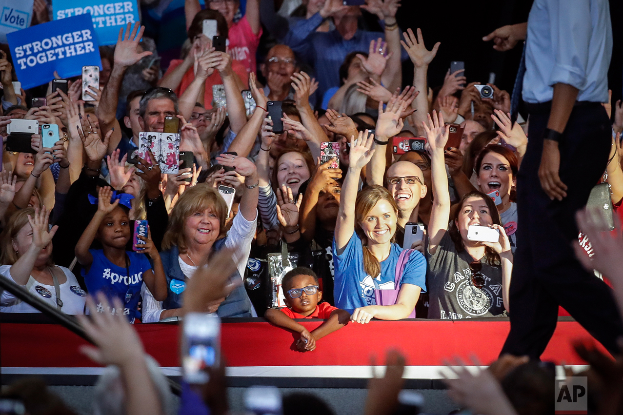 Attendees cheer as President Barack Obama, right, walks towards the podium during a campaign event for Democratic presidential candidate Hillary Clinton at Capital University, Tuesday, Nov. 1, 2016, in Columbus, Ohio. (AP Photo/John Minchillo)