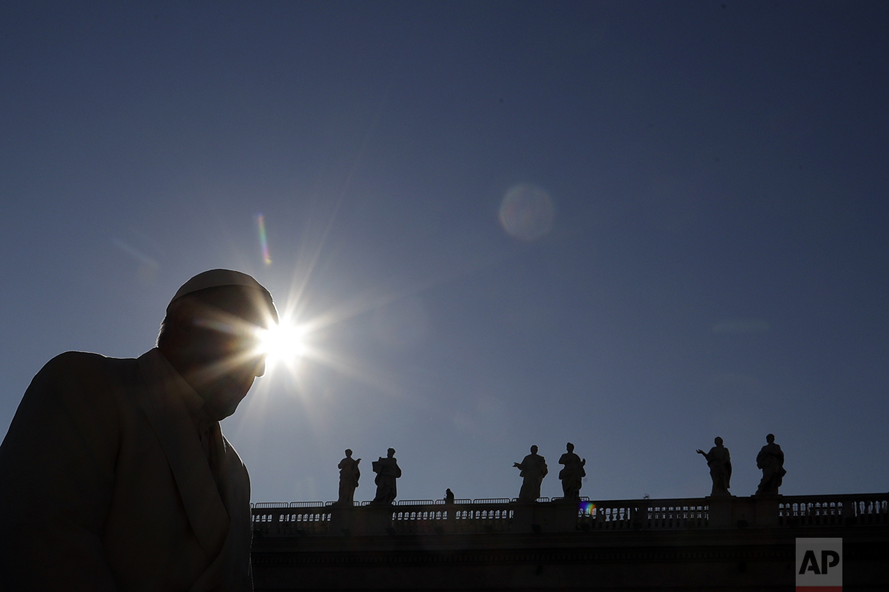Pope Francis arrives in St. Peter's Square to attend his weekly general audience at the Vatican, Wednesday, Nov. 16, 2016. (AP Photo/Gregorio Borgia)