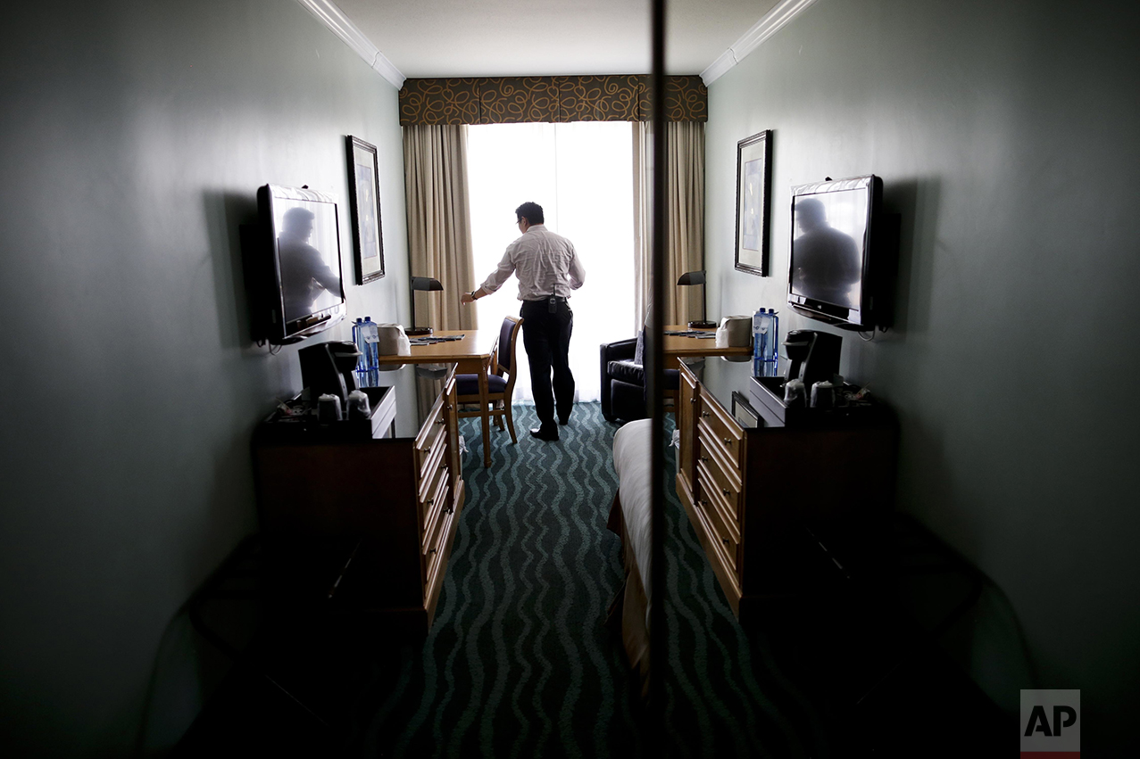 "Hotel owner Elvin Lai inspects a room as he makes his rounds at his hotel in San Diego on Friday, June 10, 2016. A fourth-generation hotelier, Lai has worked his way through nearly every job at the small beach hotel. ""Raising the minimum wage doesn't necessarily raise their ability to live,"" he said. ""It is uplifting them through certain skills and increasing their ability to earn while keeping minimum wage at a low. What does a minimum wage increase do? It raises everything. As minimum wage is going up, everything goes up. I'll have to raise my food prices on a week to week basis, as my vendors, and their vendors, increase their prices."" (AP Photo/Gregory Bull)"