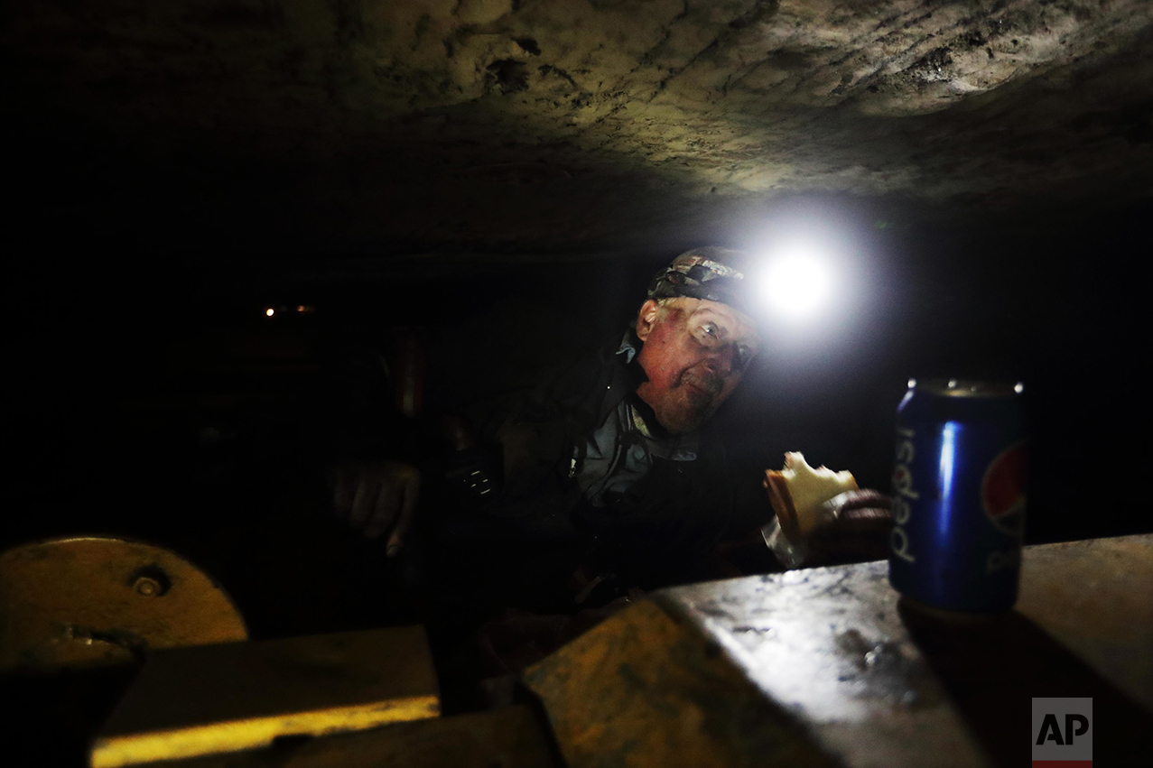 "Coal miner Scott Tiller eats a sandwich during his lunch break in a mine less than 40-inches high in Welch, W.Va. For over a century, life in Central Appalachia has been largely defined by the ups and downs of the coal industry. There is a growing sense in these mountains that for a variety of reasons - economic, environmental, political - coal mining will not rebound this time. The slump is largely the result of cheap natural gas, and older coal-fired power plants being idled to meet clean-air standards. According to the Labor Department, there were 56,700 jobs in coal mining in March, down from 84,600 in March 2009, shortly after President Barack Obama entered office. ""I have four grandchildren who are going to have to have some kind of a future,"" said Tiller. ""I don't want them being coal miners. It's a hard, tough way to make it and I just don't want that for them."" (AP Photo/David Goldman)"