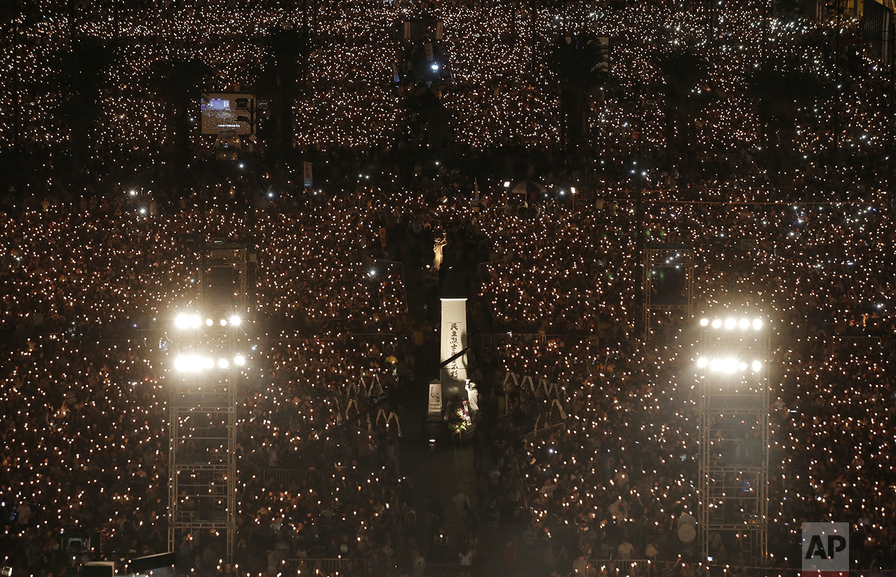Tens of thousands of people attend a candlelight vigil at Victoria Park in Hong Kong on June 4, 2016, to commemorate victims of the 1989 military crackdown in Beijing. China's bloody 1989 military crackdown on the Tiananmen Square pro-democracy protests was a pivotal moment in the country's political development. (AP Photo/Kin Cheung)