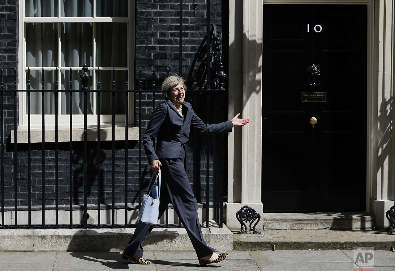 Britain's Home Secretary Theresa May leaves 10 Downing Street in London after attending a cabinet meeting there on July 12, 2016. May has become Britain's new Prime Minister. (AP Photo/Kirsty Wigglesworth)