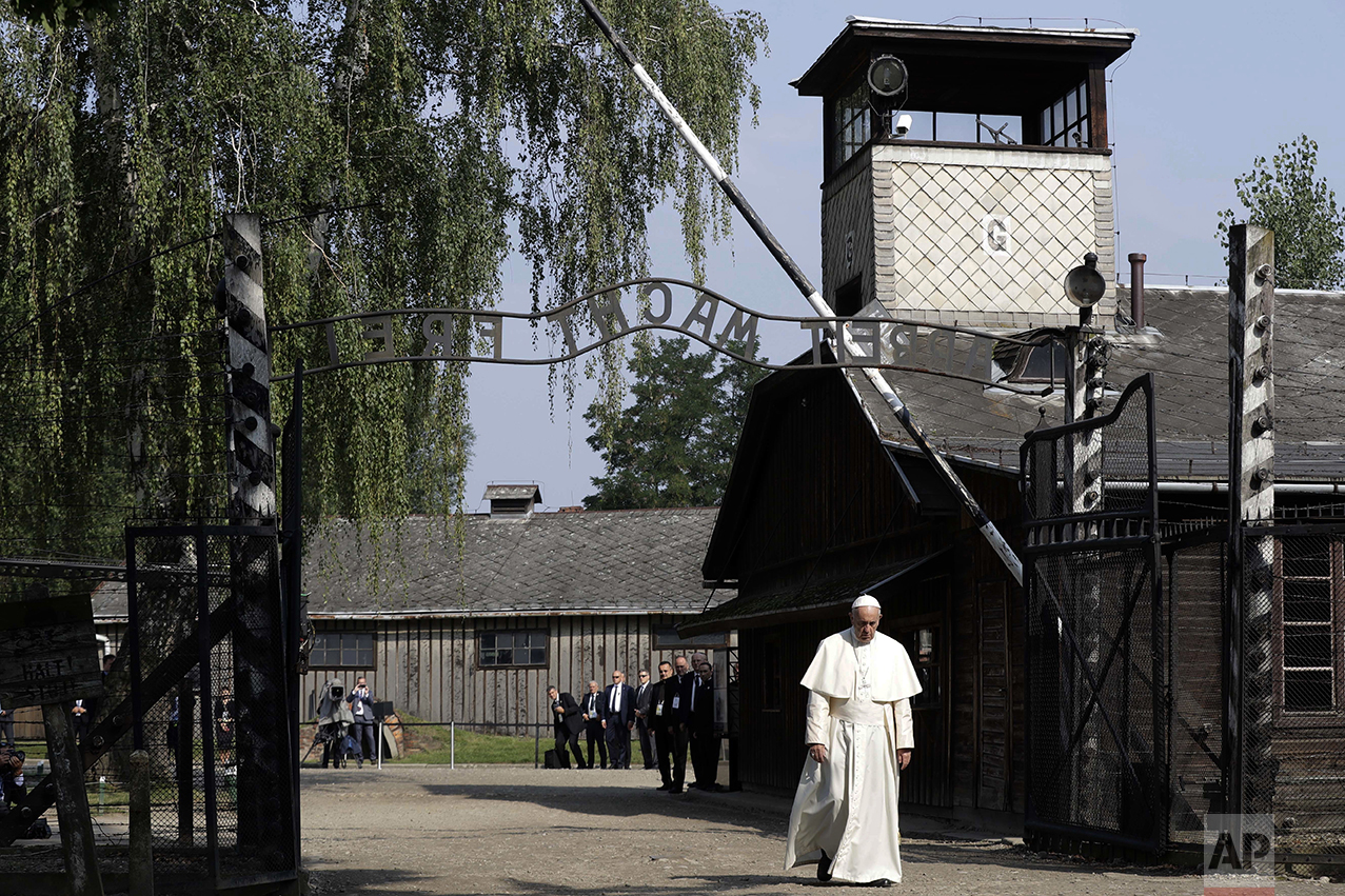 Pope Francis walks through the gate of the former Nazi German death camp of Auschwitz in Oswiecim, Poland, on July 29, 2016. (AP Photo/Gregorio Borgia)