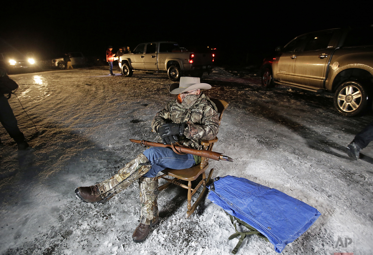 Arizona rancher LaVoy Finicum holds a gun as he guards the Malheur National Wildlife Refuge near Burns, Ore., on Jan. 5, 2016. Ammon Bundy, the leader of a small, armed group occupying the remote national wildlife preserve said earlier in the day that they will go home when a plan is in place to turn over management of federal lands to locals. (AP Photo/Rick Bowmer)