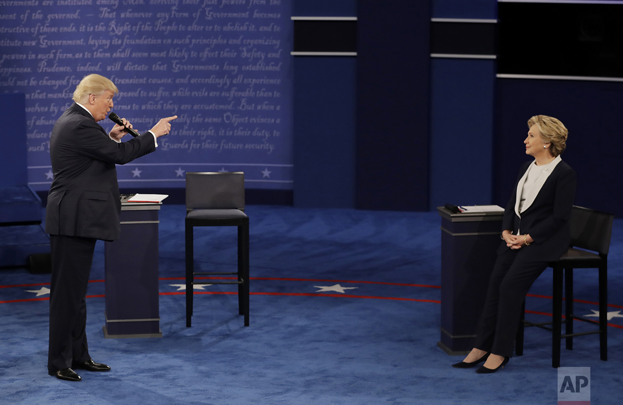 Republican presidential nominee Donald Trump speaks to Democratic presidential nominee Hillary Clinton during the second presidential debate at Washington University in St. Louis, on Oct. 9, 2016. (AP Photo/Patrick Semansky)