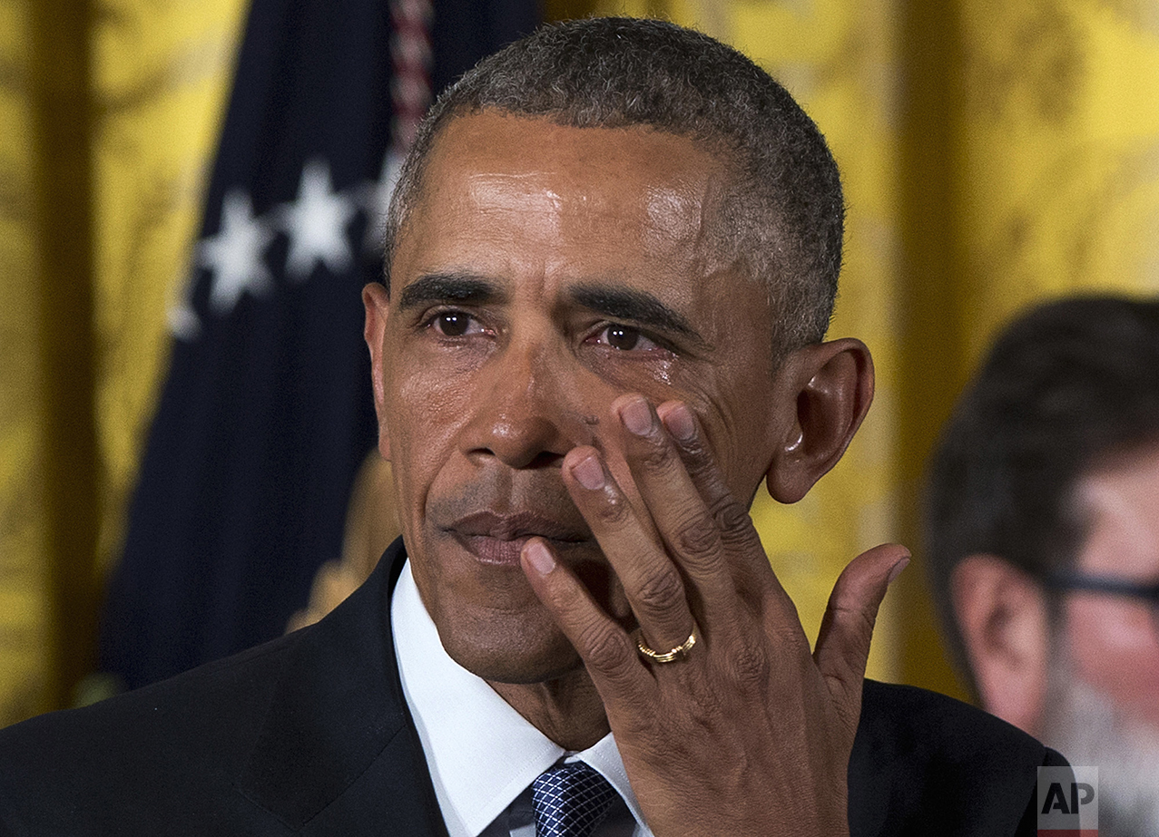 President Barack Obama wipes away tears from his eyes as he speaks in the East Room of the White House in Washington on Jan. 5, 2016, about steps his administration is taking to reduce gun violence. (AP Photo/Carolyn Kaster)