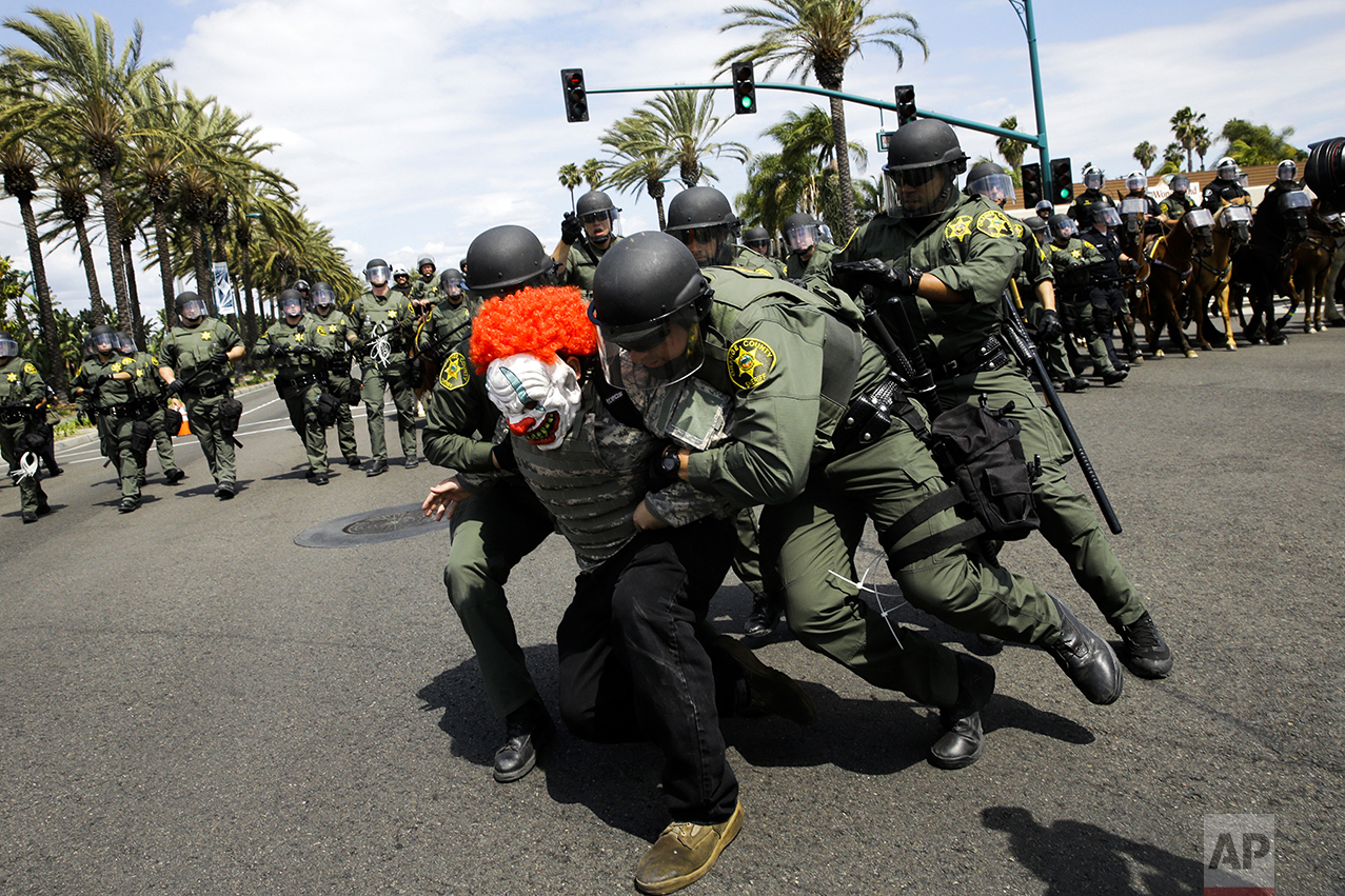Orange County Sheriff's deputies take a protester into custody outside the Anaheim Convention Center where Republican presidential candidate Donald Trump is holding a rally, on May 25, 2016, in Anaheim, Calif. (AP Photo/Jae C. Hong)