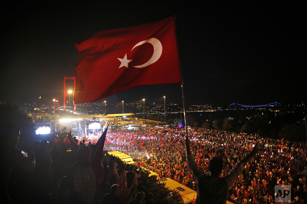 Pro-government supporters protest on the road leading to Istanbul's iconic Bosporus Bridge, background left, on July 21, 2016. Turkish lawmakers convened to endorse sweeping new powers for Turkey's President Recep Tayyip Erdogan that would allow him to expand a crackdown in the wake of a July 15 failed coup. (AP Photo/Emrah Gurel)