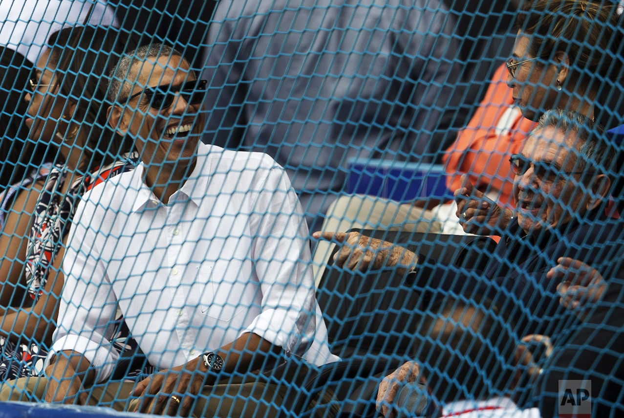 Cuban President Raul Castro, right, and U.S. President Barack Obama attend a baseball game between the Tampa Bay Rays and the Cuban national baseball team in Havana, Cuba, on March 22, 2016. The crowd roared as Obama and Castro entered the stadium and walked toward their seats in the VIP section behind home plate. It was the first game featuring an MLB team in Cuba since the Baltimore Orioles played in the country in 1999. (Ismael Francisco/Cubadebate via AP)
