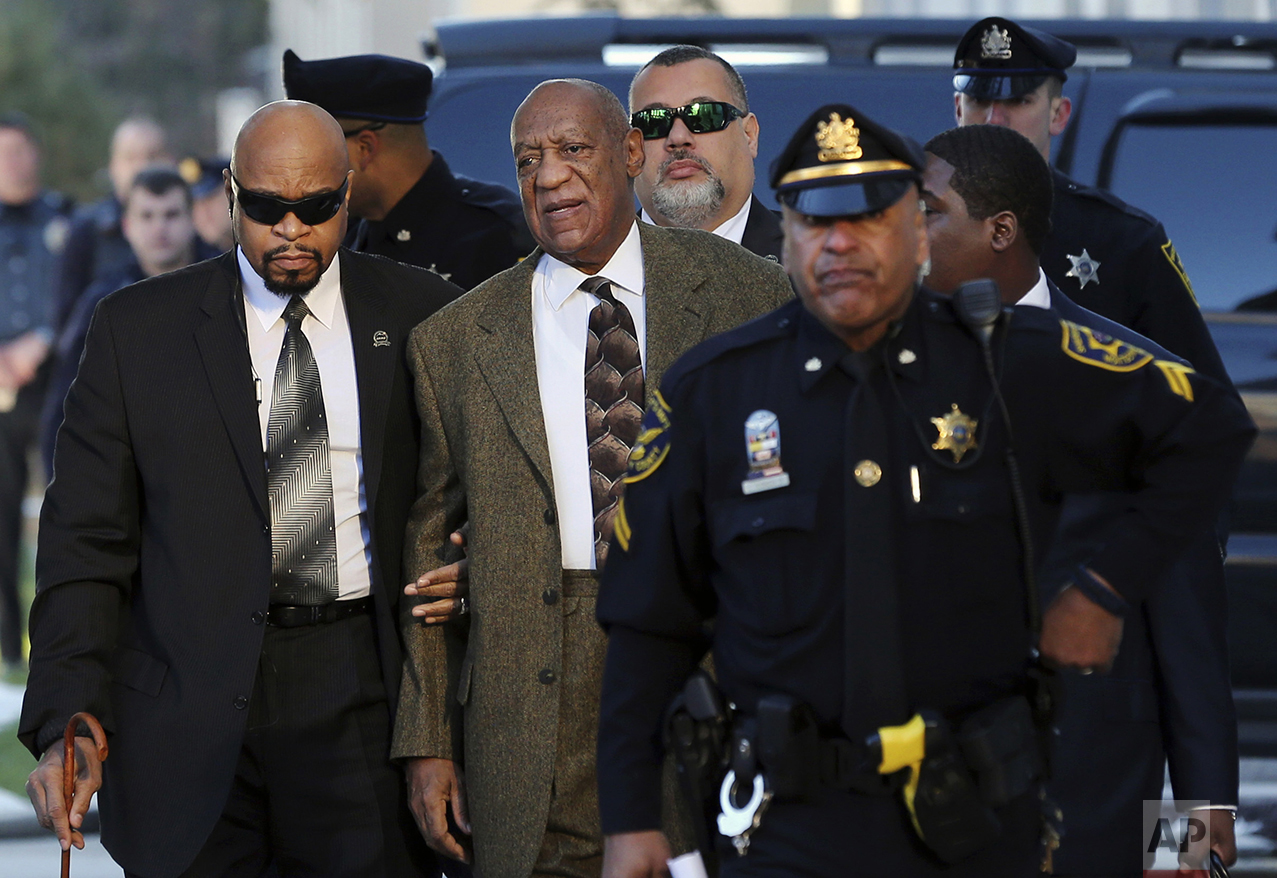 Actor and comedian Bill Cosby, center, arrives for a court appearance on Feb. 2, 2016, in Norristown, Pa. Cosby was arrested and charged with drugging and sexually assaulting a woman at his home in January 2004. (AP Photo/Mel Evans)