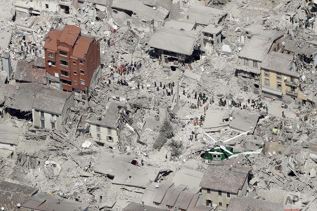 This aerial photo shows the damaged buildings in the historical part of the town of Amatrice, central Italy, after an earthquake on Aug. 24, 2016. The magnitude 6 quake struck at 3:36 a.m. (0136 GMT) and was felt across a broad swath of central Italy, including Rome where residents of the capital felt a long swaying followed by aftershocks. (AP Photo/Gregorio Borgia)