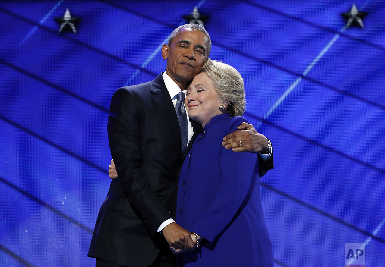 President Barack Obama hugs Democratic Presidential candidate Hillary Clinton after addressing the delegates during the third day session of the Democratic National Convention in Philadelphia, on July 27, 2016. (AP Photo/Carolyn Kaster)