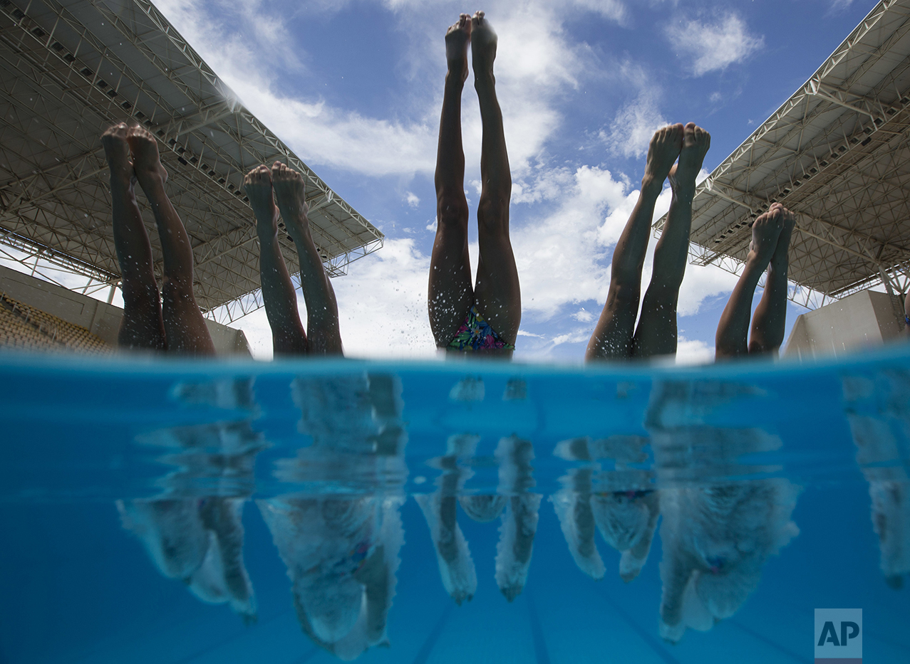 France's team dives into the pool during a training session of the Synchronized Swimming Olympic Games Qualification Tournament at the Maria Lenk Aquatics Center in Rio de Janeiro, Brazil, on March 4, 2016. (AP Photo/Felipe Dana)