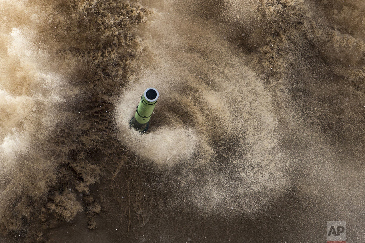 The barrel of a tank protrudes as it moves across challenging terrain during a competition in Alabino, outside Moscow, Russia, on July 30, 2016. The competition, called the International Army Games, involves troops from Russia and several other nations. (Vadim Savitsky/Russian Defense Ministry Press Service pool photo via AP)