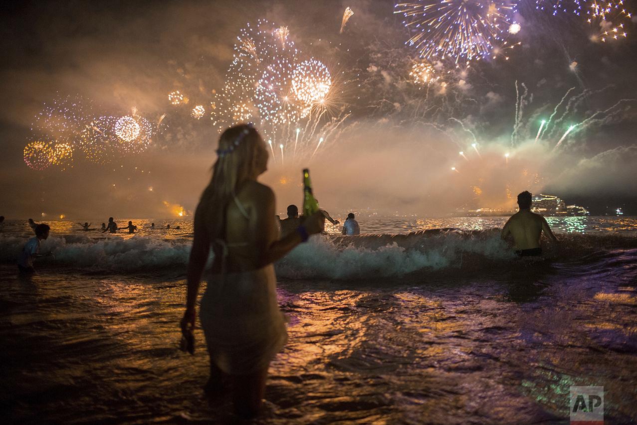 Fireworks light the sky over Copacabana beach during New Year's Eve celebrations in Rio de Janeiro, Brazil, on Jan. 1, 2016. (AP Photo/Mauro Pimentel)