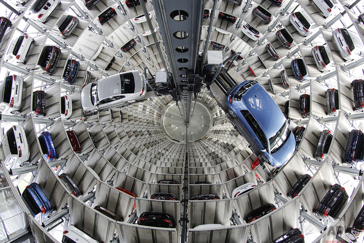 Volkswagen cars are presented to media inside a delivery tower prior to the company's annual press conference in Wolfburg, Germany, on April 28, 2016. (AP Photo/Markus Schreiber)