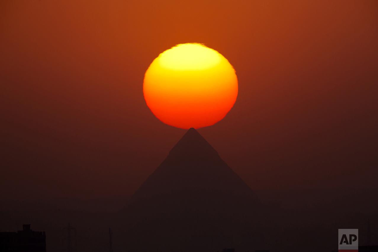 The sun sets over the the Giza Pyramids near Cairo, Egypt, on Aug. 19, 2016. (AP Photo/Amr Nabil)