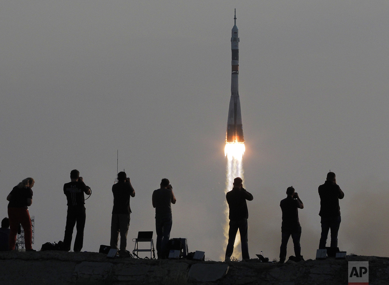 The Soyuz-FG rocket booster with Soyuz MS space ship carrying a new crew to the International Space Station, ISS, blasts off at the Russian leased Baikonur cosmodrome, Kazakhstan, on July 7, 2016. (AP Photo/Dmitri Lovetsky)