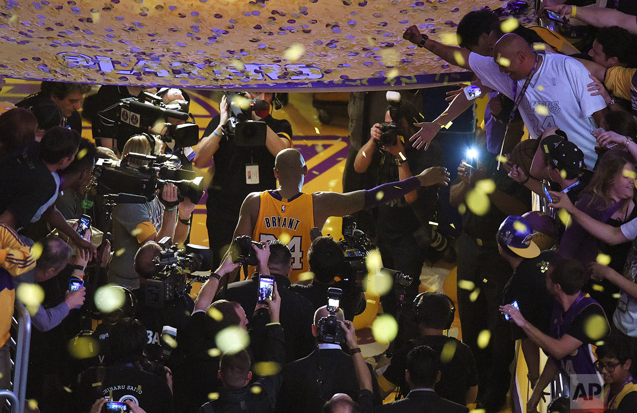Los Angeles Lakers forward Kobe Bryant walks off the court after finishing his last NBA basketball game before retirement, against the Utah Jazz, on April 13, 2016, in Los Angeles. Bryant scored 60 points as the Lakers won 101-96. (AP Photo/Mark J. Terrill)