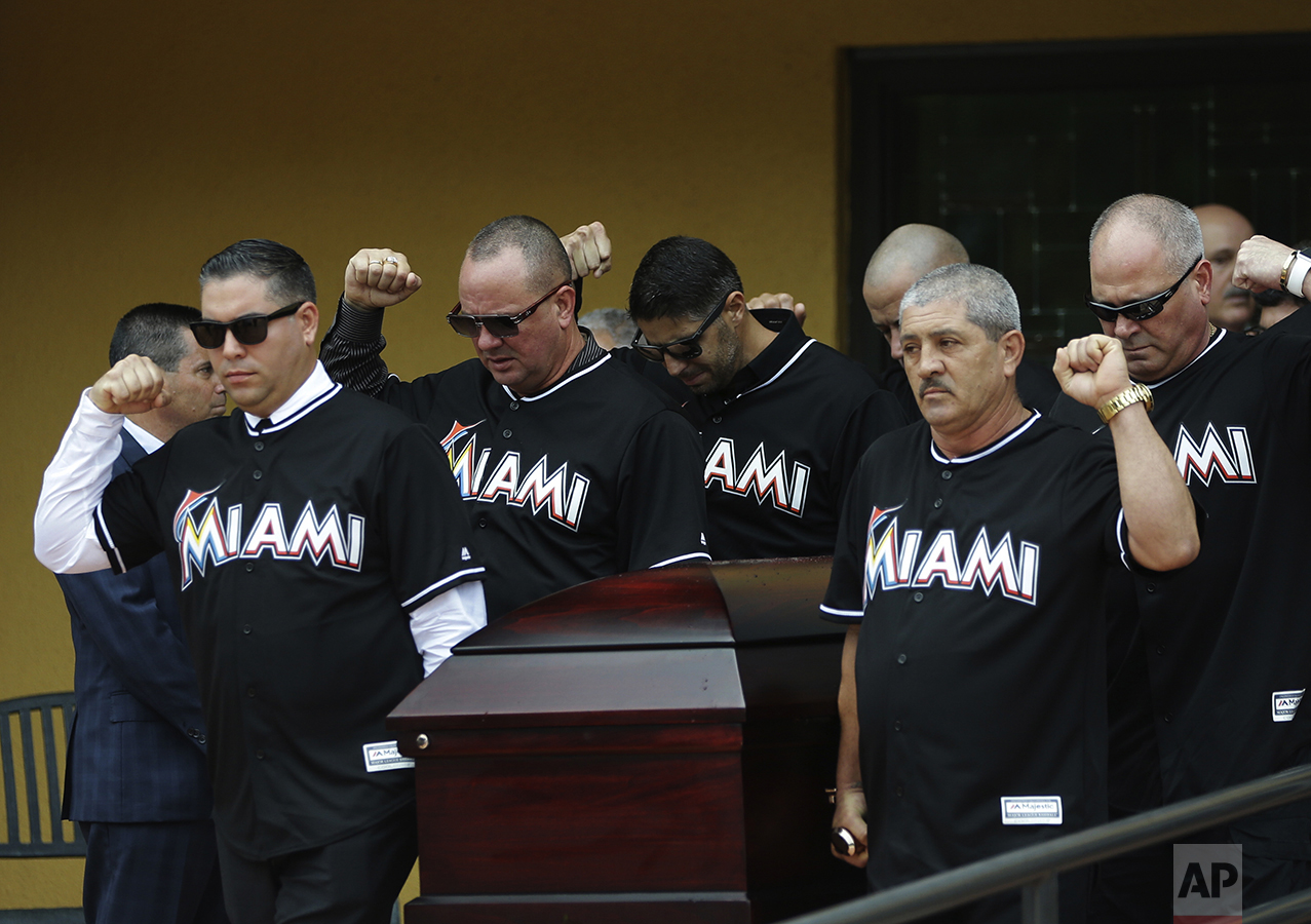Pallbearers wearing Miami Marlins jerseys carry the casket of Miami Marlins pitcher Jose Fernandez, after a funeral service at St. Brendan's Catholic Church in Miami on Sept. 29, 2016. Fernandez was killed in a boating accident along with two friends. (AP Photo/Lynne Sladky)