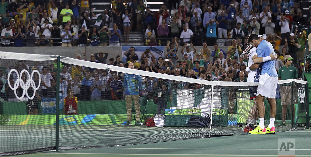 Andy Murray, of England, embraces Juan Martin del Potro, of Argentina, right, at the net after winning the gold medal in men's singles at the 2016 Summer Olympics in Rio de Janeiro, Brazil, on Aug. 14, 2016. (AP Photo/Charles Krupa)