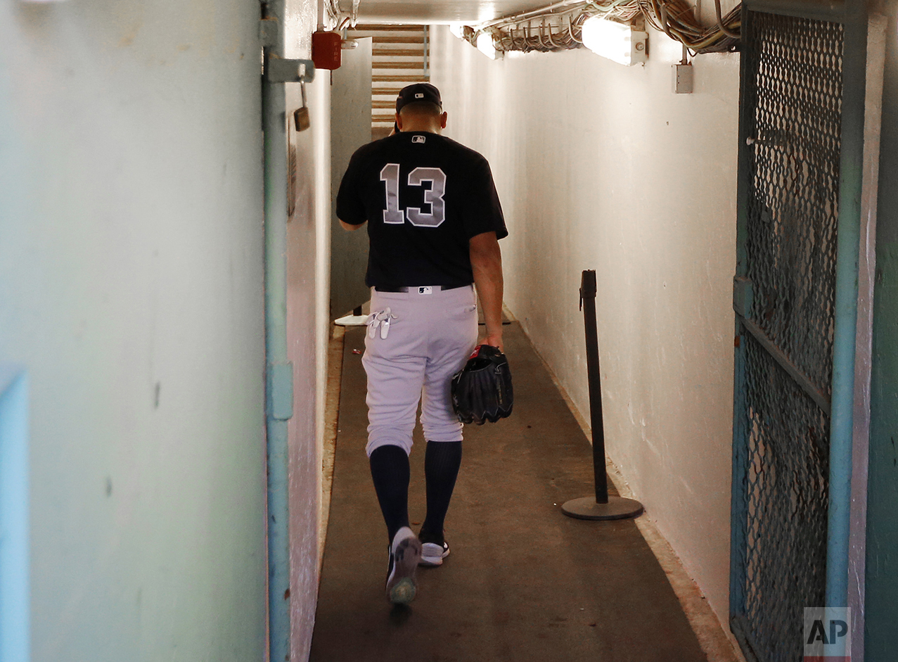 New York Yankees' Alex Rodriguez walks back down the tunnel to the clubhouse before the team's baseball game against the Boston Red Sox at Fenway Park in Boston on Aug. 9, 2016. Rodriguez played his final Major League Baseball game later the same week in New York. (AP Photo/Winslow Townson)