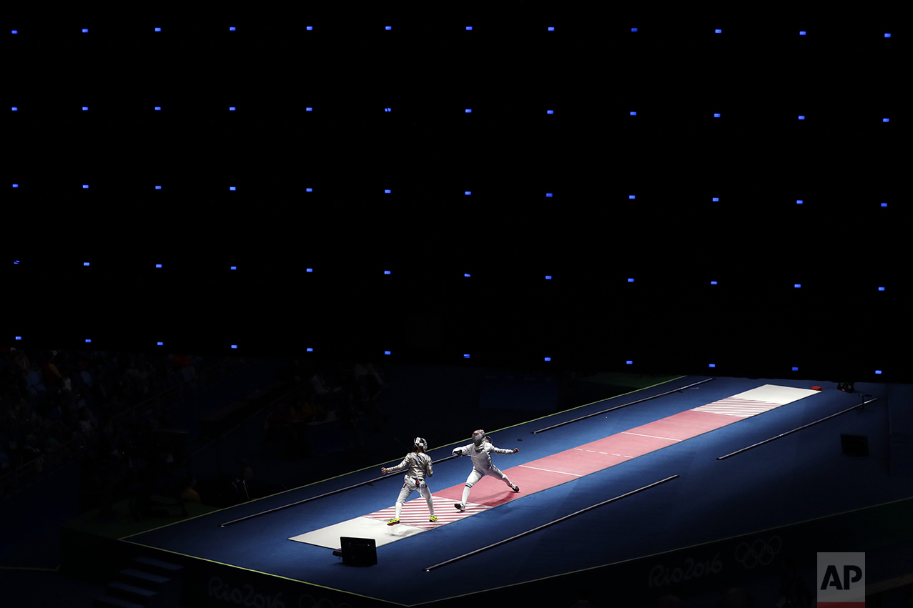 Anna Marton of Hungary, right, fences against Manon Brunet of France during women's saber individual fencing competition in the 2016 Summer Olympics in Rio de Janeiro on Aug. 8, 2016. (AP Photo/Gregory Bull)