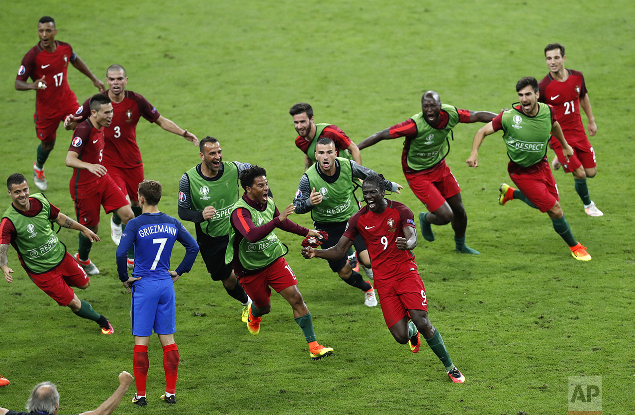 Portugal's Eder, front right, celebrates after scoring the opening goal during the Euro 2016 final soccer match between Portugal and France at the Stade de France in Saint-Denis, north of Paris, on July 10, 2016. (AP Photo/Michael Sohn)