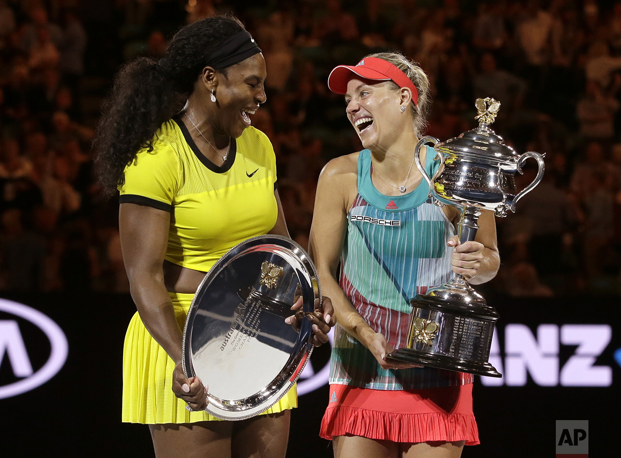 Angelique Kerber, right, of Germany enjoys a joke with runner-up Serena Williams of the United States after winning their women's singles final at the Australian Open tennis championships in Melbourne, Australia, on Jan. 30, 2016. (AP Photo/Aaron Favila)