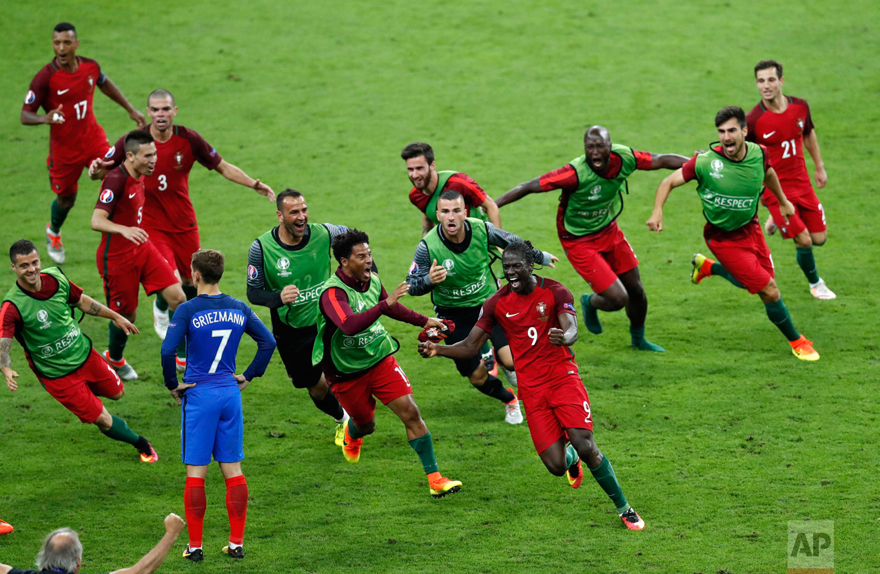 In this Sunday, July 10, 2016 photo, Portugal's Eder, front right, celebrates after scoring the opening goal during the Euro 2016 final soccer match between Portugal and France at the Stade de France in Saint-Denis, north of Paris. (AP Photo/Michael Sohn)