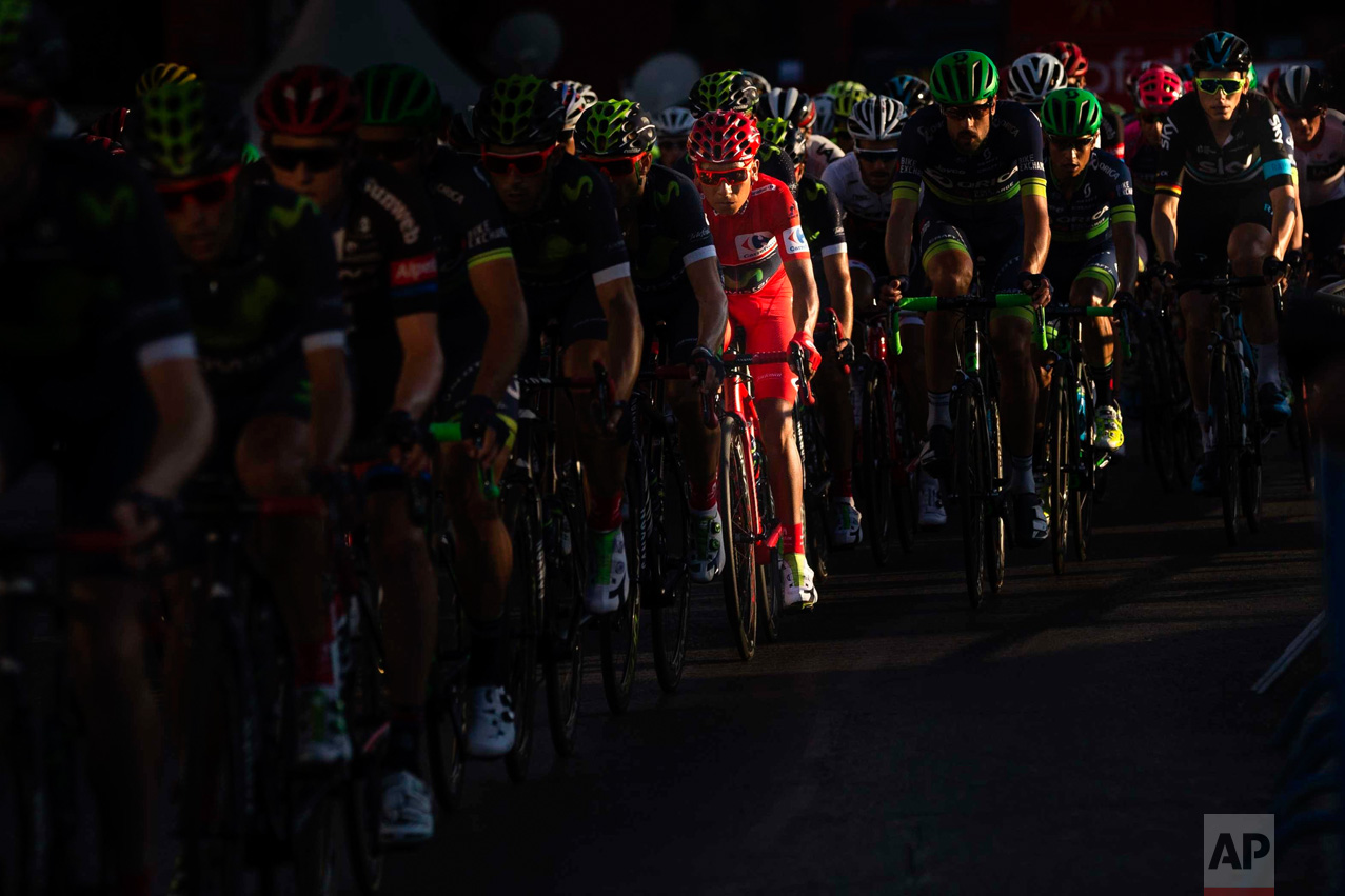 In this Sunday, Sept. 11, 2016 photo, Movistar's Team Nairo Quintna of Colombia rides wearing the overall red jersey rides to win the Spanish La Vuelta cycling tour that finished in Madrid, Spain. (AP Photo/Daniel Ochoa de Olza)