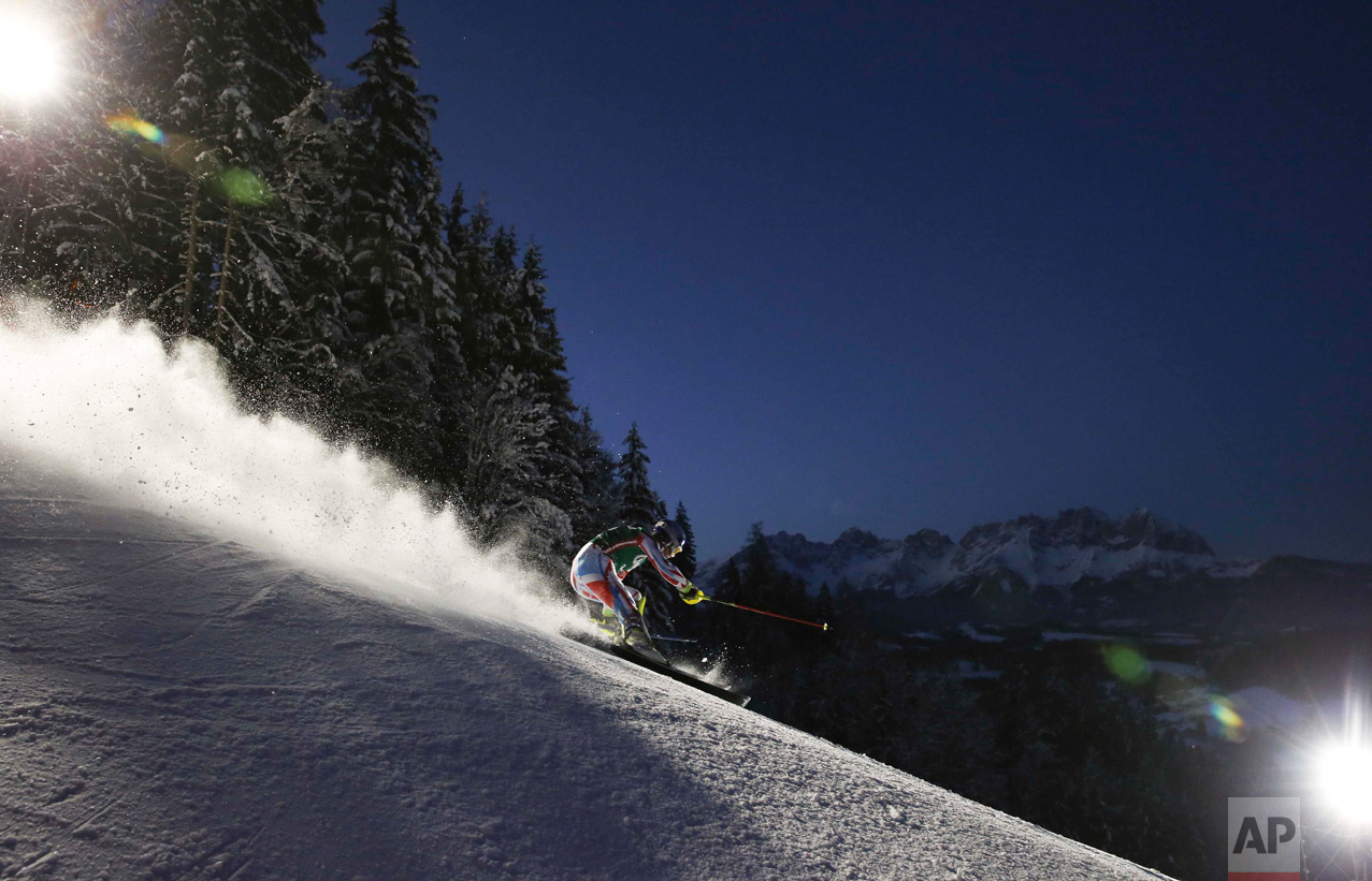 In this Friday, Jan. 22, 2016 photo, France's Alexis Pinturault speeds down the slope during the slalom portion of an Alpine ski, men's World Cup combined, in Kitzbuehel, Austria. (AP Photo/Shinichiro Tanaka)
