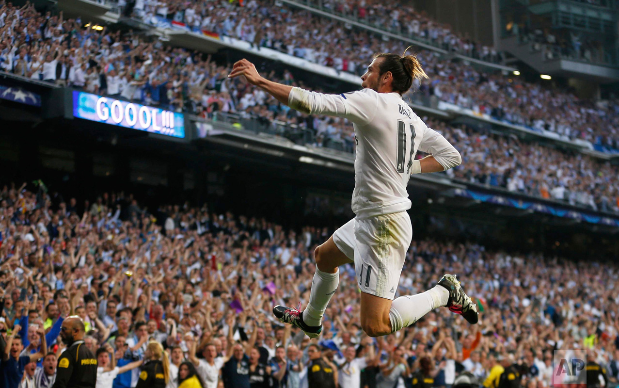 In this Wednesday May 4, 2016 photo, Real Madrid's Gareth Bale celebrates after scoring the opening goal during the Champions League semifinal second leg soccer match between Real Madrid and Manchester City at the Santiago Bernabeu stadium in Madrid. (AP Photo/Francisco Seco)