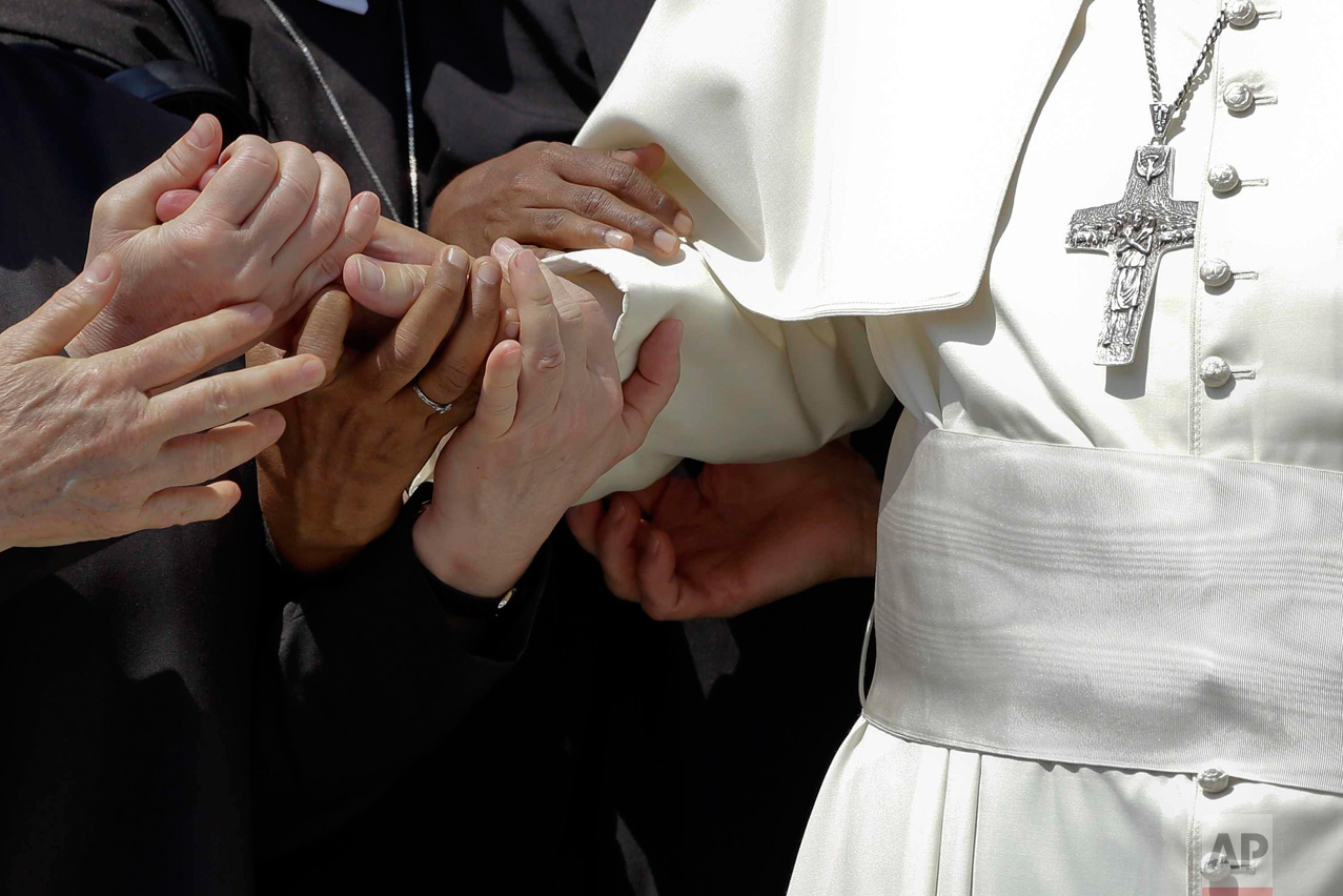 In this Thursday, June 30, 2016 photo, Pope Francis is greeted by nuns in St. Peter's Square on the occasion of a jubilee audience, at the Vatican. (AP Photo/Gregorio Borgia)