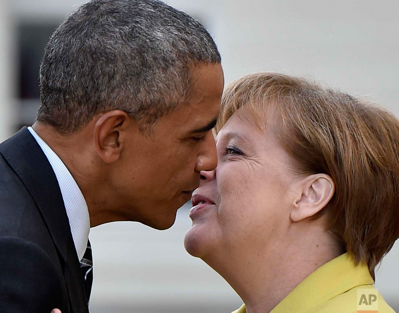 In this Sunday, April 24, 2016 photo, German Chancellor Angela Merkel, right, welcomes U.S. President Barack Obama at Herrenhaus Palace in Hannover, northern Germany. Obama is on a two-day official visit to Germany. (AP Photo/Martin Meissner)