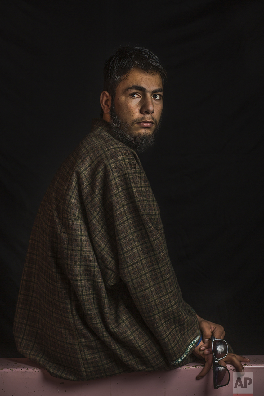 "In this Dec. 1, 2016 photo, Nasir Fayaz Mir, 16, poses for a portrait in Pattan, Indian-controlled Kashmir. The most recent protests erupted in early July after Indian troops killed Burhan Wani, a young and charismatic militant commander and sparked off more than five months of angry street protests in the Kashmir valley. Health officials say that in the past five months more than 6,000 people, mostly young men, have been injured by shotgun pellets, including hundreds blinded in one or both eyes. Nasir was wounded in July and lost eyesight in his right eye. He has to wear sunglasses to protect his damaged eyes from the light and the dust. ""I felt as the whole universe turned dark."" (AP Photo/Bernat Armangue)"