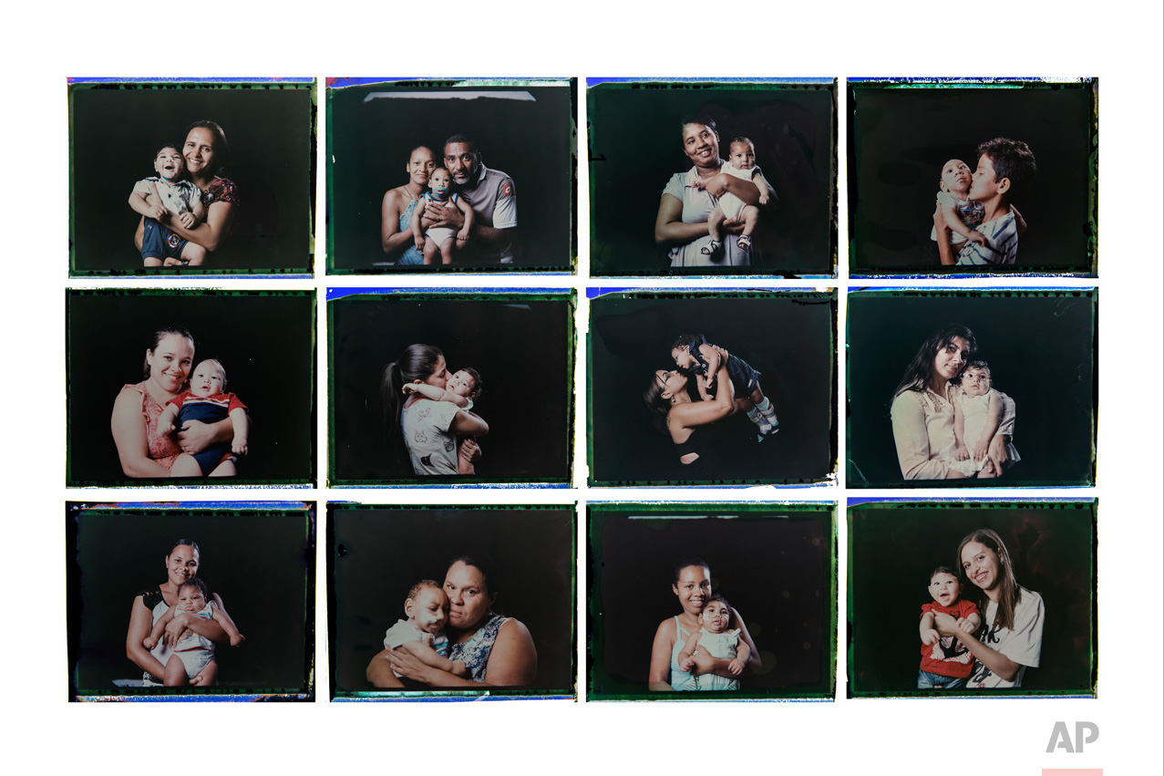 In this combo of photos taken between Sept. 26 and Oct. 1, 2016, mothers and relatives pose with their babies, diagnosed with microcephaly linked to the Zika virus, in Pernambuco state, Brazil. Associated Press photographer Felipe Dana has followed these babies from hospitals to their cribs, from brain exams to bath time since the outbreak began in Brazil. After several interviews and assignments with the mothers, he wanted to capture the mothers' pride for their children, using instant film so they could immediately see and keep the photographs. (AP Photo/Felipe Dana)